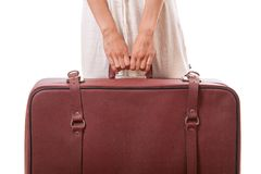 Vintage suitcase in female hands Royalty Free Stock Photos