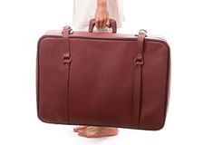 Vintage suitcase in female hands Stock Photos