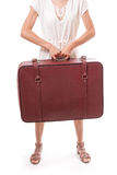 Vintage suitcase in female hands Stock Images