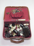 Vintage suitcase full of unusual antique electrical parts. Vintage suitcase full of unusual old electrical parts Royalty Free Stock Photography