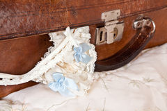 Vintage suitcase and garter Stock Photography