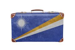 Vintage suitcase with Marshall Islands flag. Isolated on white background Stock Photography