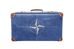 Vintage suitcase with Nato flag Stock Photography