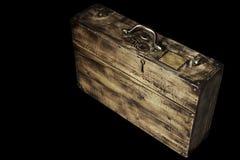 Vintage suitcase. Old wooden suitcase on black background stock image