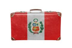 Vintage suitcase with Peru flag. Isolated on white background close stock photos