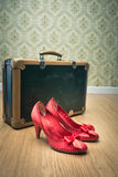 Vintage suitcase and red shoes Stock Photography
