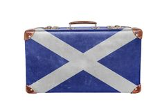 Vintage suitcase with Scotland flag. Isolated on white background close stock photo