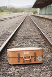 Vintage Suitcase. Sitting on railway tracks at station Stock Photography