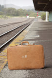 Vintage Suitcase. Sitting on a train station platform Stock Images