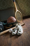 Vintage suitcase with sports equipment Royalty Free Stock Photos