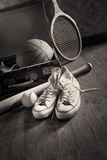 Vintage suitcase with sports equipment Stock Image