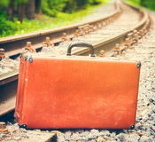 Vintage suitcase standing beside the railway Royalty Free Stock Photography
