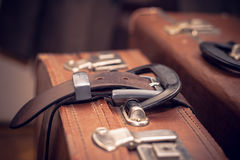 Vintage suitcase strapped a belt Stock Photo