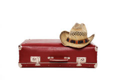 Vintage suitcase and straw hat. On a white background, travel, vacation - concept Stock Photos