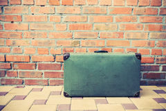 Vintage suitcase on the street Royalty Free Stock Photos