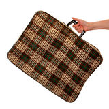 Vintage suitcase in stripes hold by females hand Royalty Free Stock Image