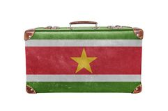 Vintage suitcase with Suriname flag. Isolated on white background close Royalty Free Stock Photo
