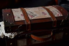 Vintage suitcase with table linen Royalty Free Stock Image