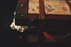 Vintage suitcase with table linen Royalty Free Stock Images