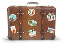 Vintage suitcase with travel stickers  on white backgrou Royalty Free Stock Image