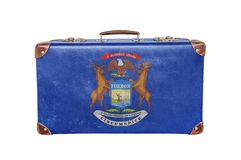 Vintage suitcase with Michigan flag royalty free stock photography