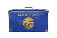 Vintage suitcase with Montana flag royalty free stock photography
