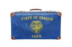 Vintage suitcase with Oregon flag Stock Images