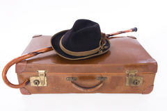 Vintage suitcase with walking stick and hat Stock Photo