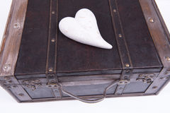 Vintage suitcase on white background with heart Stock Photo