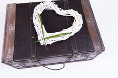 Vintage suitcase on white background with heart Stock Photos