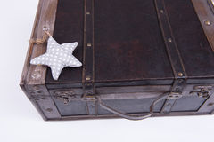 Vintage suitcase on white background with star Royalty Free Stock Photography