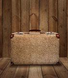 Vintage suitcase on wooden plank background Royalty Free Stock Image