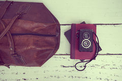 Vintage suitcases with books and camera Royalty Free Stock Photos