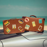 Vintage suitcases on cabriolet car. Summer vacation and travel concept Royalty Free Stock Photo