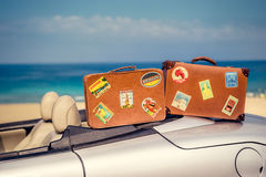 Vintage suitcases on cabriolet car Royalty Free Stock Images