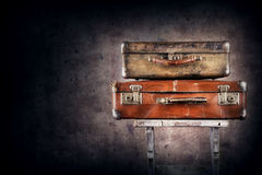 Vintage suitcases on chair stock photography