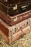 Vintage suitcases on hay Royalty Free Stock Image
