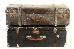 Vintage suitcases isolated. Vintage suitcase -one on top of the other Stock Photos