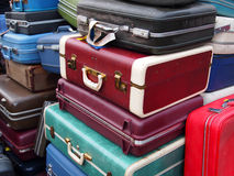 Vintage Suitcases In A Pile. A huge pile of old suitcases in many colors piled up together Royalty Free Stock Images