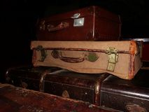 Vintage Suitcases. Pile of vintage suitcases in the dark room Royalty Free Stock Images