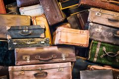 Vintage suitcases pile. Vintage different suitcases pile background Stock Images