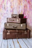 Vintage suitcases. Pyramid of several vintage suitcases on a pink background toned picture close-up shallow depth of field Royalty Free Stock Photos