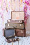 Vintage suitcases. Pyramid of several vintage suitcases on a pink background toned picture close-up shallow depth of field Royalty Free Stock Photo