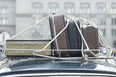 Vintage suitcases on the roof car. Stock Photo