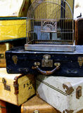 Vintage Suitcases. A stack of vintage suitcases with a birdcage on top Royalty Free Stock Image