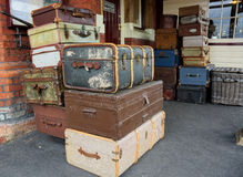 Vintage suitcases. A stack of vintage suitcases and hamper on a railway station platform Royalty Free Stock Photo