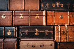 Vintage suitcases background. Vintage suitcases stacked in a heap. Traveling concept. Background Stock Photography