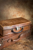 Vintage suitcases. Two closed very old leather vintage suitcases with copyspace Royalty Free Stock Image
