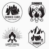 Vintage summer camp logo set. Camping badges and outdoor adventure emblems. Original typography with camping tent, bonfire. Vintage summer camp logo set royalty free illustration