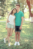 Vintage summer portrait modern couple teenagers in the park Royalty Free Stock Image